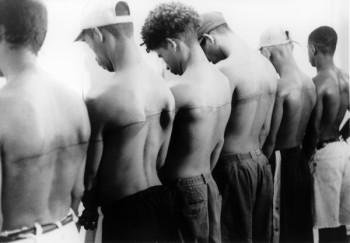 Santiago Sierra, Line of 250cm Tattooed on Six Paid People